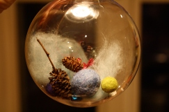 DIY Christmas balls; purchase wool, felted wool balls, and plastic ornament from Michaels.  Include items from nature.  Lovely grandparent gifts.